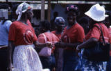 Women wearing political t-shirts, Grenada