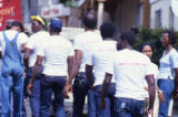 "People walking with ""Liberty, Justice, Love"" written on t-shirts, Grenada"