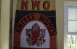 "Sign: ""NWO Unites Women,"" Grenada"