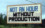 "Sign: ""Not an Hour Without Production,"" Grenada"