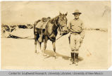 Unidentified soldier with his horse.