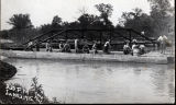People on pier by bridge over Animas River