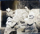 Daisy Wright with her nephew and Helen Marshall
