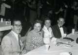 Fabián Chávez, Jr. sitting with Coral Jeanne Chavez, Esther Collado, and Angel B. Collado