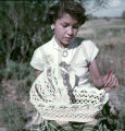 American Indian woman working with completed bassinet