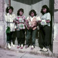 Four Plains American Indian women standing in doorway