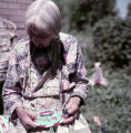 Plains American Indian woman working on traditional crafts