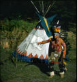 """""Plains Souix Dance"""", Plains American Indian in front of dwelling"