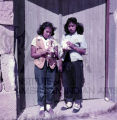 Two Plains American Indian women standing in doorway