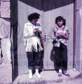 Two American Indian women standing in doorway