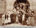 Photo taken of students and teachers in front of the First Ward School in Albuquerque, New Mexico