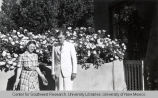 William A. and Loretta Barrett Keleher in Yard with Roses