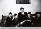 William A. Keleher Reading With Sons