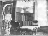 """Dining room with view into front parlor"""
