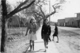 """Walking to school on Main St., Los Lunas, New Mexico"""