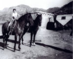 Andres Cordova with horses, Cordova Ranch