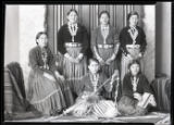 Portrait of Elizabeth Huskie Burnside sitting with an Indian School group