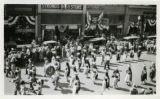 Photograph of a Native American marching band during a 1922 parade in Albuquerque