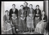Portrait of Elizabeth Huskie Burnside standing with an Indian School group