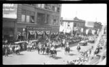 Photograph of mounted riders and convertibles during a 1922 parade in Albuquerque
