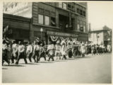 Photograph of Native American drummers walking during a 1922 parade in Albuquerque