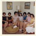 Seven ladies sitting together at Dr. Frank Angel's party