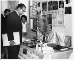 Dr. John Aragón looking at one of the educational displays