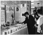 People looking and reading from one of the many educational displays