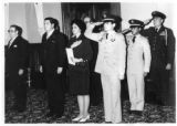 Ambassador Mari-Luci Jaramillo standing at attention for the national anthem at the presentation...