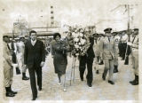Ambassador Mari-Luci Jaramillo and her Deputy carry a floral arrangement to the monument of...