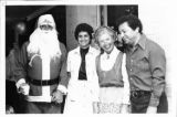 "Ambassador Mari-Luci Jaramillo and Dr. Heriberto Jaramillo with ""Mr. and Mrs. Claus"" at Christmas..."