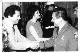 Ambassador Mari-Luci Jaramillo and  Dr. Heriberto Jaramillo greet the colonels at an ambassadorial...