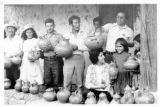 Ambassador Mari-Luci Jaramillo and Dr. Heriberto Jaramillo visit with the potters of La Campa,...