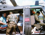Ambassador Mari-Luci Jaramillo getting settled into a helicopter