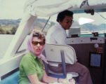 Dr. Heriberto Jaramillo and Mrs. Frank Divine on a boat in Panama
