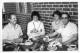 Ambassador Mari-Luci Jaramillo enjoying the company of other guests at a barbeque hosted by the...