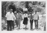 Ambassador Mari-Luci Jaramillo walks with officials to view new road opened with AID funds near...