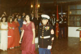 "Ambassador Mari-Luci Jaramillo and Marine march down the center of the ballroom to receive ""the..."
