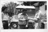 Ambassador Mari-Luci Jaramillo watches as Colonel Seeley gives a driver the keys he is to drive in...