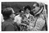 Two unidentified people speaking together as Ambassador Mari-Luci Jaramillo looks during a visit...