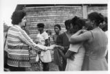 Ambassador Mari-Luci Jaramillo greets unidentified women that have come out to greet her in...