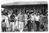 Ambassador Mari-Luci Jaramillo leaving a school with unidentified people in Cauquira, Honduras