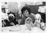 Ambassador Mari-Luci Jaramillo  posing with two children wearing masks in a Honduran school
