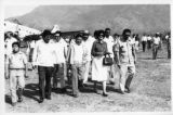 Ambassador Mari-Luci Jaramillo is escorted from a plane by the  people of Flor del Este