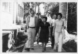 Ambassador Mari-Luci Jaramillo walking with school officials on the  campus of Escuela Normal de...