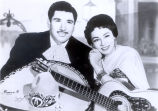 Man and woman with guitars