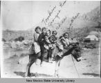 Five children on a mule