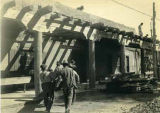 Men carrying viga (beam) during remodeling of the Palace of the Govenors, Santa Fe, New Mexico