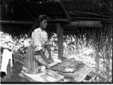 Indian girl making tortillas, Quirigua, Guatemala