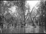 Short West and Hugh Wheeler in canoe on Cache la Poudre River near Greeley, Colorado